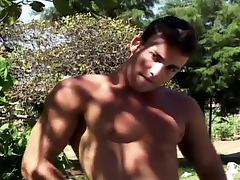 Young muscled hunk jerking off outdoors