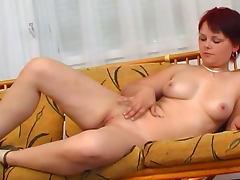 Redhead babe Evelin masturbates her pussy