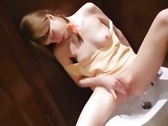 Teen cunt masturbation with bidet
