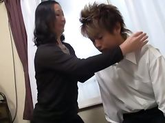 Hardcore action with a mature Japanese teacher porn video