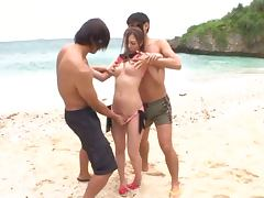 Julia enjoys sucking and riding two cocks on a beach