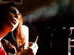 Slender brunette is smoking in a sexy way as never before