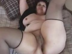 Mature fattie shows off her snatch and pleases herself with fingering