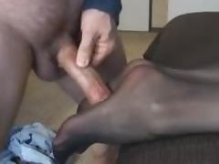 Pretty girl gives a footjob and gets cum on her nylon pantyhose porn video
