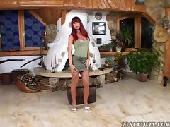 Sonya the hot redhead girl toys her pussy and pees