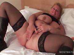 Charming mature blonde rubs her cunt with panties