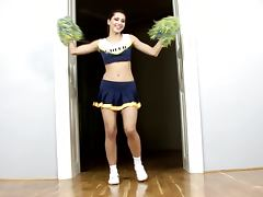 Hot cheerleader Anne finger fucks her juicy cunt indoors