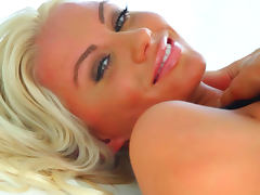 Sensual smiling blonde Sarah Summers is demonstrating her tits