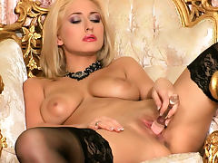 Glamorous blonde Carina Shay shows off her puss