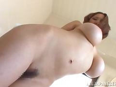 An Asian slut with brilliant baloobas plays with them
