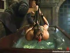 Tied up and gagged girl gets drowned in an aquarium