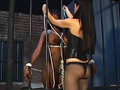 Ebon disco playgirl with biggest milk sacks is tied and caged by hot female dom