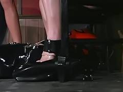 Thick woman tied with leather restraints
