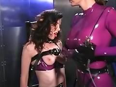 Latex dominatrix punishes captured dark brown