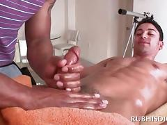 Sexy stud gets his hard dick sucked by gay masseur