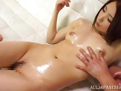 Oiled up Yuki Kanade toys her pussy and gets fingered