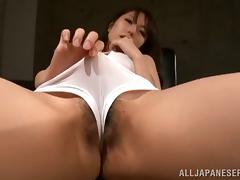 Sexy Japanese girl in a swimsuit masturbates on an armchair
