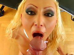 Curly-haired blonde swallows sperm