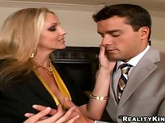 Julia Ann the slutty blonde MILF gets nailed in a bedroom porn video