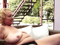 Fat blonde granny plays lesbian games with a cute brunette near a pool porn video
