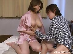 Gorgeous Japanese milf gives her tits to him