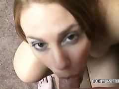 Busty redhead Mariah swallows a cock