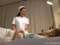 Mature Japanese nurse gives a handjob and gets fucked