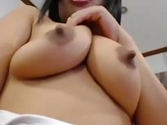 Busty Asian smacks her hairy beaver