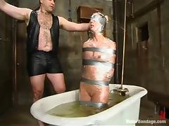 Redhead hussy Ivy gets drowned and humiliated in a hot BDSM clip