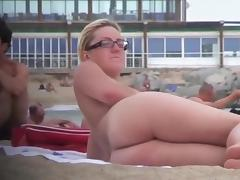 Gorgeous women relaxing on the nudist beach butt naked