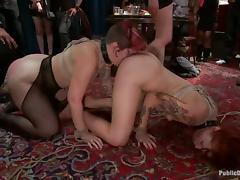 Tina Horn moans loudly while getting her cunt fisted in a group scene