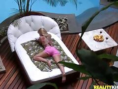 Pretty blonde in bikini shows her passion for anal sex