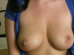 Slender brunette shows off her big tits on webcam