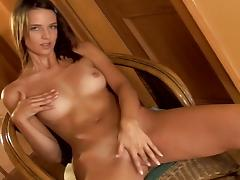 Tanned beauty Aneta is masturbating her accurate puss
