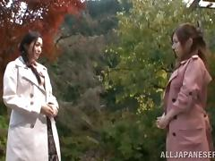 Two gorgeous Japanese babes are going lesbian under the Sakura tree