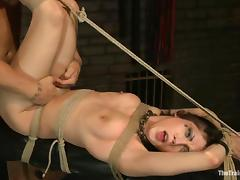 Tied up Asphyxia Noir gets fucked in her mouth and vagina