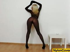Smoking hot blond siren puts on her nylon suit and fucks herself