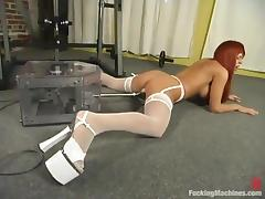 Redhead bitch Nikki gets her coochie slammed by a fucking machine