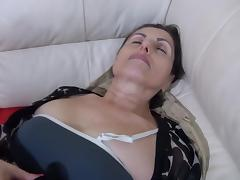 Dona is lying naked with a hot dildo