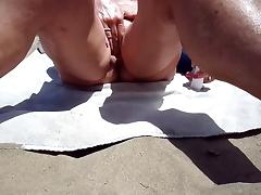 Mature sex toy playing down dunes