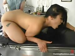 Mika Tan moans loudly while getting her vag smashed by a fucking machine