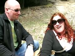Fat redhead mom plays lesbian games with a slim blonde in a forest