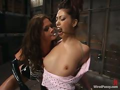 Satine Phoenix gets her snatch licked and fucked with a strapon