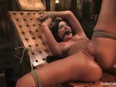 Busty brunette girl gets her pussy fucked in bondage video