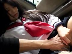 Japanese college girl allows some guy to finger her vag in a car