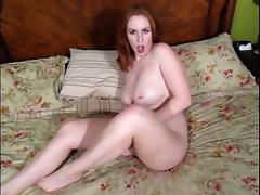 Busty redhead chick is touching herself with passion