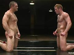 Oiled up wrestlers sucks dicks and fuck on a the mat