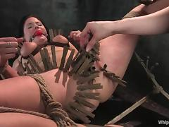 A brunette rides a fucking machine after getting pinched in BDSM clip