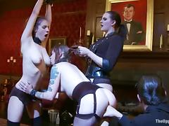 Iona Grace and Sparky Sin Claire share a toy in lesbian BDSM vid