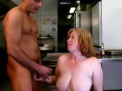The restaurant kitchen fun with a horny mature lady